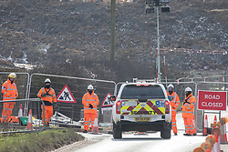 Harefield, UK. 13th February, 2021. A security vehicle approaches a road closure on Harvil Road in the Colne Valley set up in order to facilitate the felling of some of the few remaining trees in the area for the HS2 high-speed rail link. Four anti-HS2 activists had been evicted from a roadside camp and three from nearby trees by bailiffs acting for HS2 Ltd during the night.