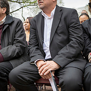 Monacan Chief, Dean Branham, listens as Alan Michelson, a Mohawk member of Six Nations of the Grand River, speaks during the dedication ceremony for Mantle: Virginia Indian Tribute, a monument designed on Virginia State Capitol Square, in Richmond, Virginia, on Tuesday, April 17, 2018. Michelson, a New York based artist, designed the monument in Capitol Square next to the Bell Tower along North Ninth Street. John Boal Photography