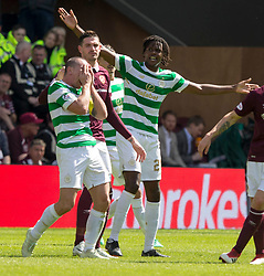 Celtic's Scott Brown holds his face after clashing with Hearts Kyle Lafferty during the Ladbrokes Scottish Premiership match at Tynecastle Stadium, Edinburgh.