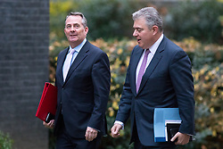 © Licensed to London News Pictures. 05/12/2017. London, UK. International Trade Secretary Liam Fox and Minister of State for Immigration arriving in Downing Street to attend a Cabinet meeting this morning.Yesterday, Brexit negotiations on the Northern Ireland border were stalled when Arlene Foster of the DUP said she could not support commitment to keep Northern Ireland aligned with EU laws. Photo credit : Tom Nicholson/LNP