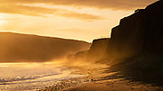 On a glorious evening at the tip of North Wales the lo sunshine backlit clouds of spray from the long lines of surf rolling into the bay. Movement caught the corner of my eye and I watched three sheep scramble up to the top of. steep cliff - just a wonderful liitle moment.