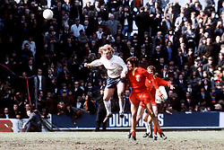 England's Bobby Moore (l) heads clear from Wales' John Toshack (r)