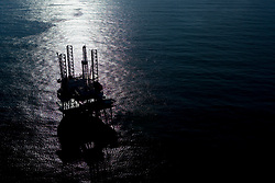 Aerial view of jackup oil drilling rig at twilight.