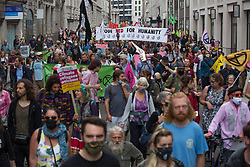 © Licensed to London News Pictures.  27/08/2021. London, UK. Members of Extinction Rebellion march through central London as they protesting against the use of Fossil fuels. Photo credit: Marcin Nowak/LNP