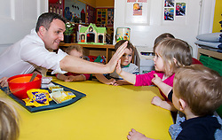 Pictured: Alex Cole-Hamilton, Scottish Liberal Democrat candidate for Edinburgh Western high fives Farah Smith<br /> <br /> Scottish Liberal Democrat leader Willie Rennie marked the first full day of campaigning for the Scottish Election by visiting  the New Town Nursery in Edinburgh. He was joined by Edinburgh Western candidate Alex Cole-Hamilton as the children were enjoying a lively morning<br /> <br /> Ger Harley | EEm 23 March 2016