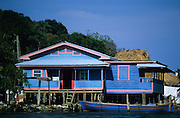 Bay Islands. Roatàn, Oak Ridge, a tiny fishing harbour, consists of a long row of colorful wooden houses nestled around the sea.