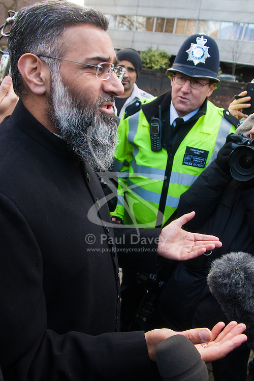 Regent's Park Mosque, London, February 27th 2015. A small group of Islamic Radicals demonstrate after Friday prayers, calling for the release of Islamist Sheikh Omar Bakri Muhammad from prison in Lebanon's Roumeih prison. They say he is unwell and has suffered torture. PICTURED: Anjem Choudary talks to the press