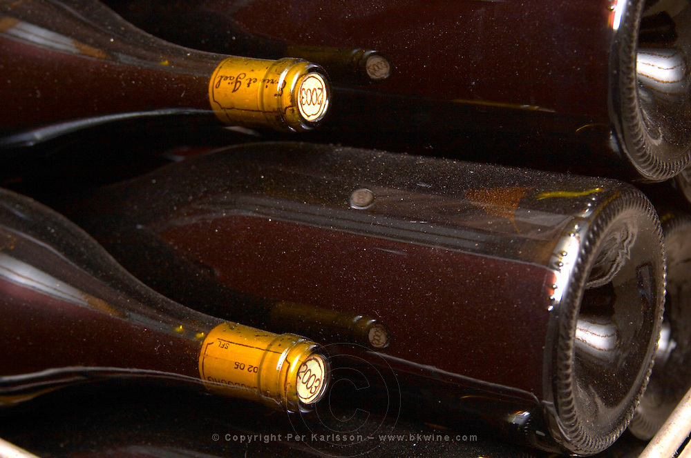 Bottles lying down with corks stamped with the vintage 2003. Domaine Eric et Joel Joël Durand, Ardeche, Ardèche, France, Europe
