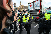 Police and demonstrators argue face-to-face during a 'Kill the Bill' protest outside the houses of Parliament in London on Saturday, April 3, 2021. The demonstration is against the contentious Police, Crime, Sentencing and Courts Bill, which is currently going through Parliament and would give police stronger powers to restrict protests. (Photo/ Vudi Xhymshiti)