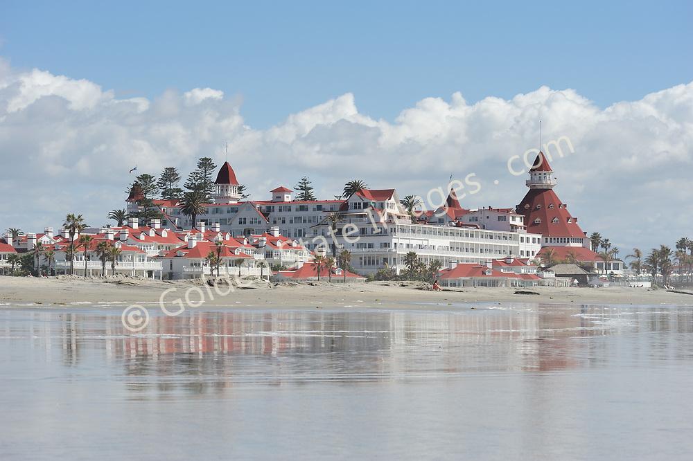 The Hotel Del reflected in the intertidal sand flats of Coronado beach.