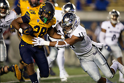 California running back Damien Moore (28) stiff arms Nevada linebacker Daiyan Henley (11) during the first quarter of an NCAA college football game, Saturday, Sept. 4, 2021, in Berkeley, Calif. (AP Photo/D. Ross Cameron)