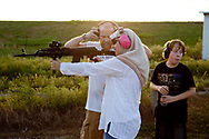 Misty Holmes fires an AK-47 at a shooting range outside of Oswego, Kansas on August 27, 2011. Abdul-Hakim, who served in the army, is a certfied concealed carry instructor and a member of the NRA.