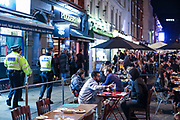 People drinking outside a bar in Soho, London on Friday, Oct 9, 2020 -  ahead of the 10 pm curfew. Pubs and restaurants are subject to in order to curb the spread of coronavirus. Boris Johnson is to outline a new three-tiered system of coronavirus restrictions on Monday that is expected to cause pubs and restaurants to shut across the north of England. (VXP Photo/ Vudi Xhymshiti)