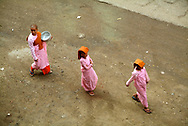 """The Buddhist Nuns in Myanmar are called Thilashins wich means """"possessor of morality"""". They observe the ten precepts and are easy recognised by their pink robes, orange shawl, shaven head and metal alms bowl. Thilashins go out on alms rounds during the day of observance and receive uncooked rice or money."""