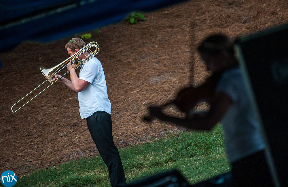 Members of the Charlotte Symphony warm up prior to performing at the Symphonic Stars & Stripes Salute at Village Park in Kannapolis on July 2, 2014.