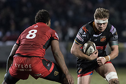 Lewis Evans of the Dragons runs at Edinburghs' Bill Mata.<br /> <br /> Photographer Simon Latham/Replay Images<br /> <br /> Guinness PRO14 - Dragons v Edinburgh - Friday 23rd February 2018 - Eugene Cross Park - Ebbw Vale<br /> <br /> World Copyright © Replay Images . All rights reserved. info@replayimages.co.uk - http://replayimages.co.uk