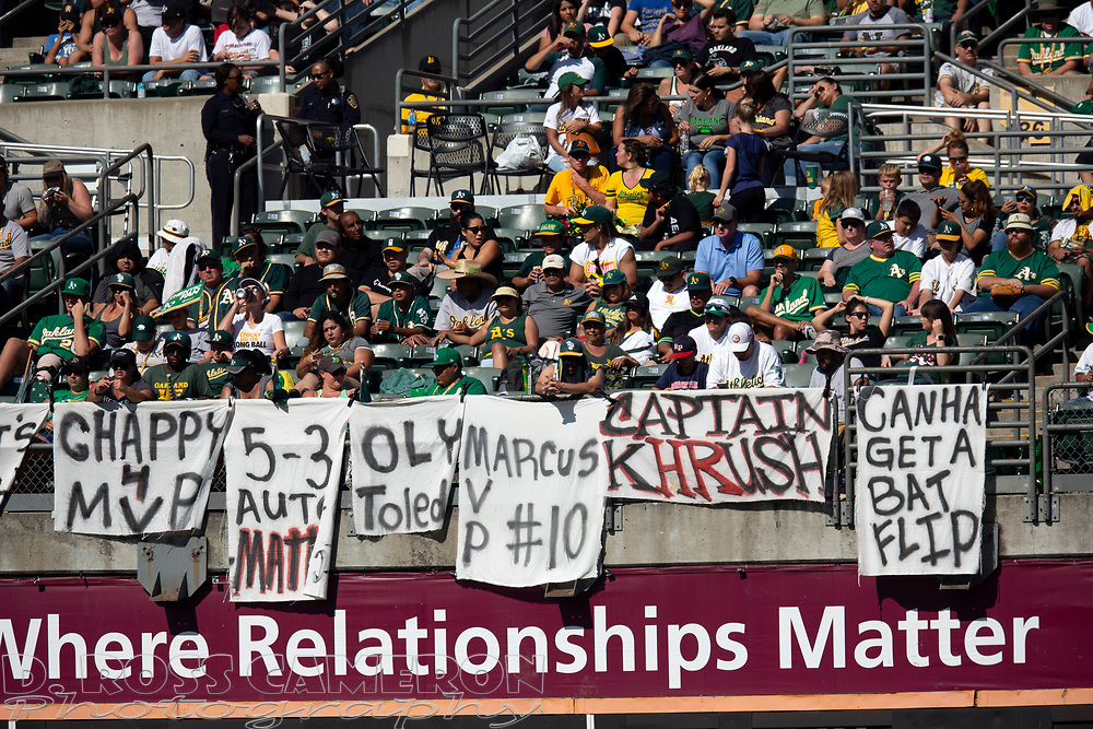 Oakland Athletics fans drape the bleachers with messages for their team during a baseball game against the Texas Rangers, Sunday, Sept. 22, 2019, in Oakland, Calif. (AP Photo/D. Ross Cameron)