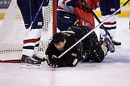 October 13, 2007 - Anchorage, Alaska:  Jared Katz (7) of the Wayne State Warriors has his helmet knocked off during the Warriors 1-4 loss to Robert Morris in the 3rd game of the Nye Frontier Classic at the Sullivan Arena.  RMU would go on to be the Classic Champions after host Alaska-Anchorage tied with Boston University in the 4th game of the Classic.