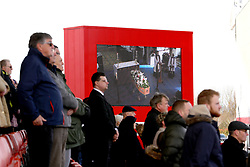 Mourners watch the funeral service for Gordon Banks on the big screens at the bet365 Stadium, Stoke.