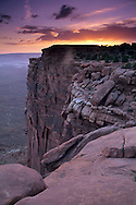 Sunset over red cliffs and mesa at Green River Overlook, Island in the Sky, Canyonlands National Park, UTAH