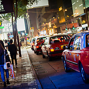 Taxis waiting in line at Tsim Sha Tsui, Hong Kong
