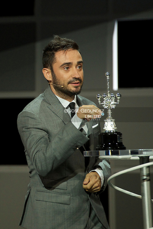Director Juan Antonio Bayona delivers the Donosti Lifetime Achievement Award to Ewan McGregor during 60th San Sebastian International Film Festival at the Kursaal Palace on September 27, 2012 in San Sebastian, Spain.