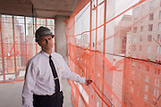 Investigative Engineering Services, Assistant Commissioner Tim Lynch inspecting a new construction site in Manhattan, New York City.