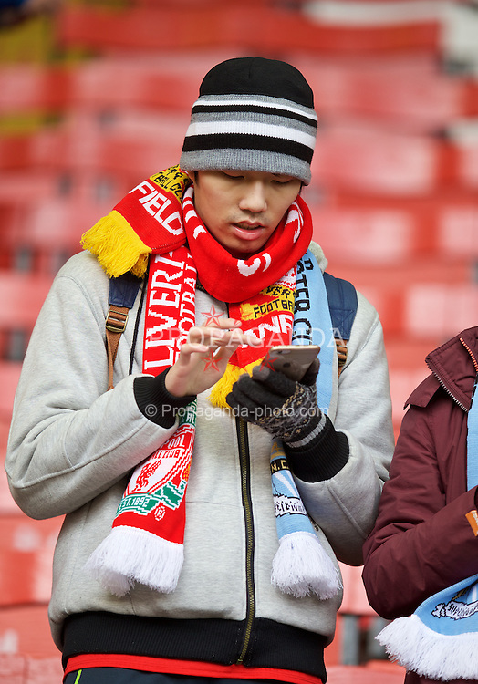 LIVERPOOL, ENGLAND - Sunday, March 1, 2015: A Liverpool supporter before the Premier League match against Manchester City at Anfield. (Pic by David Rawcliffe/Propaganda)