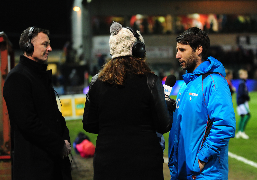 Lincoln City manager Danny Cowley is interviewed by BBC Radio 5, and ex Lincoln manager Chris Sutton before kick off<br /> <br /> Photographer Andrew Vaughan/CameraSport<br /> <br /> Emirates FA Cup Third Round Replay - Lincoln City v Ipswich Town - Tuesday 17th January 2017 - Sincil Bank - Lincoln<br />  <br /> World Copyright © 2017 CameraSport. All rights reserved. 43 Linden Ave. Countesthorpe. Leicester. England. LE8 5PG - Tel: +44 (0) 116 277 4147 - admin@camerasport.com - www.camerasport.com