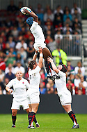 5th September 2010, Twickenham Stoop, London, England: Maggie Alphonsie of England catches a lineoug during the IRB Women's Rugby World Cup final between England and New Zealand Black Ferns. New Zealand won 13-10, capturing the trophy for the 4th time.  (Photo by Andrew Tobin www.slikimages.com)
