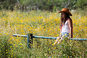 Pensive girl of 12 in a field