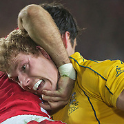 David Pocock, Australia, is held by Mike Phillips, Wales, during the Australia V Wales Bronze Final match at the IRB Rugby World Cup tournament, Auckland, New Zealand. 21st October 2011. Photo Tim Clayton...