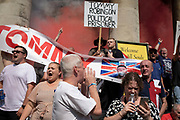 Free Tommy Robinson demonstrators let off smoke flares and shout slogans at their opposition organised by anti-fascist groups including Stand up to Racism opposed to far right politics on 24th August 2019 in London, United Kingdom. Some 250 Stand Up To Racism and other anti-fascist groups took to the streets today in opposition to supporters of jailed 'Tommy Robinson' real name Stephen Yaxley-Lennon at Oxford Circus, who gathered outside the BBC.
