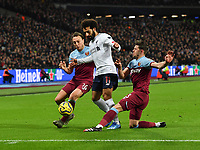 Football - 2019 / 2020 Premier League - West Ham United vs. Liverpool<br /> <br /> Liverpool's Mohamed Salah is tackled by West Ham United's Aaron Cresswell and Mark Noble, at The London Stadium.<br /> <br /> COLORSPORT/ASHLEY WESTERN