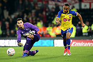 Derby County goalkeeper Kelle Roos releases the ball as Southampton midfielder Tyreke Johnson chases it down during the The FA Cup 3rd round match between Derby County and Southampton at the Pride Park, Derby, England on 5 January 2019.
