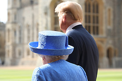 US President Donald Trump and Queen Elizabeth II walk in the Quadrangle at Windsor Castle, Windsor.