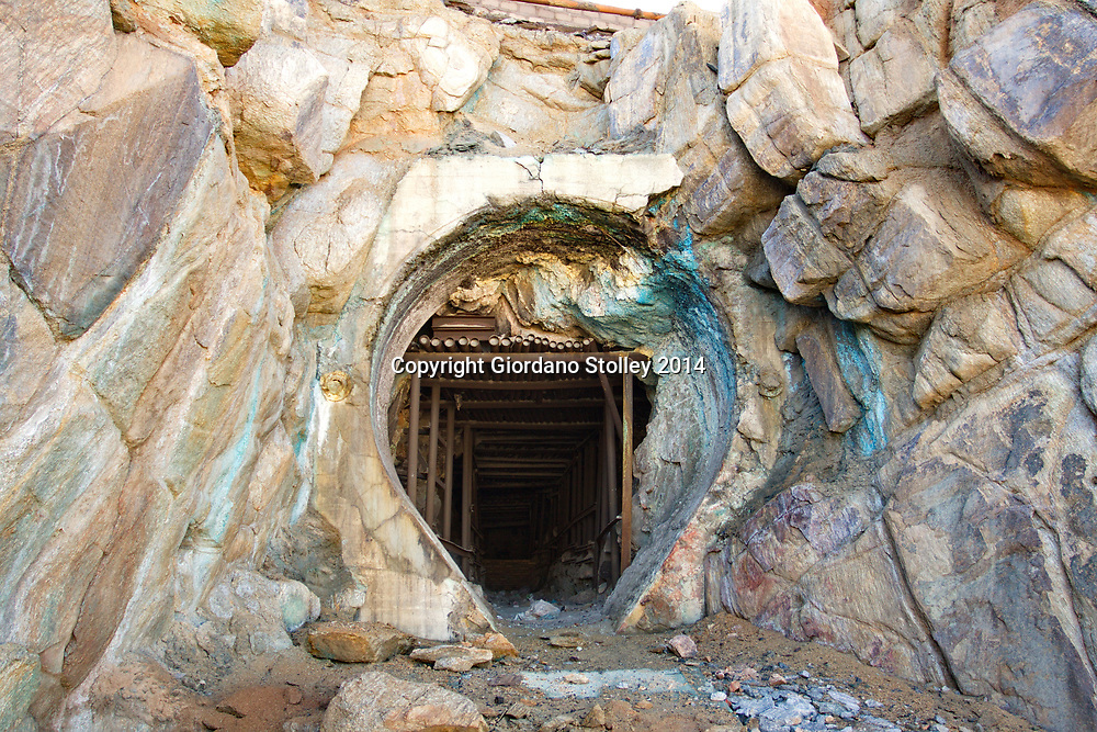 NABABEEP, South Africa - 7 July 2014 - The entrance to one of the disused shafts at the Nababeep Mine Museum in the Northern Cape town of Nababeep. The mine, from which copper was extracted, closed down in 2004 after beig in operation for about 150 years. The local Nababeep Mine Museum bears testimony to this history, its immediate surrounds a display of old mining equipment and Clara - a narrow-gauge 'mountain type' steam locomotive.