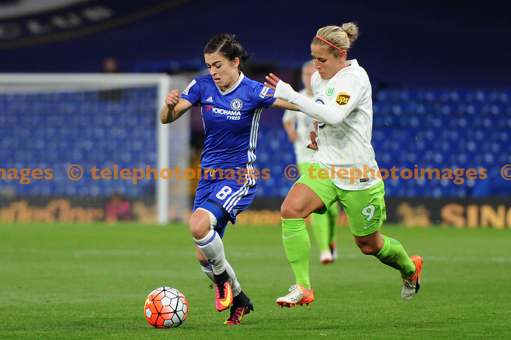 Chelseas Karen Carney and Wolfsburgs Anna Blässe in action during the UEFA Women's Champions League match between Chelsea and Wolfsburg at Stamford Bridge in London. October 5, 2016.<br />Holly  Allison / Telephoto Images<br />+44 7967 642437