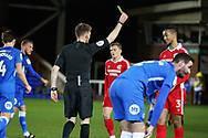 Referee Ollie Yates shows a yellow card to Scunthorpe Utd defender Cameron Borthwick-Jackson (3) during the EFL Sky Bet League 1 match between Peterborough United and Scunthorpe United at London Road, Peterborough, England on 1 January 2019.