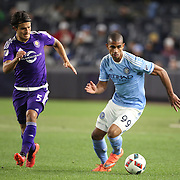 Tony Taylor, (right), NYCFC, is challenged by Servando Carrasco, Orlando, during the New York City FC Vs Orlando City, MSL regular season football match at Yankee Stadium, The Bronx, New York,  USA. 18th March 2016. Photo Tim Clayton