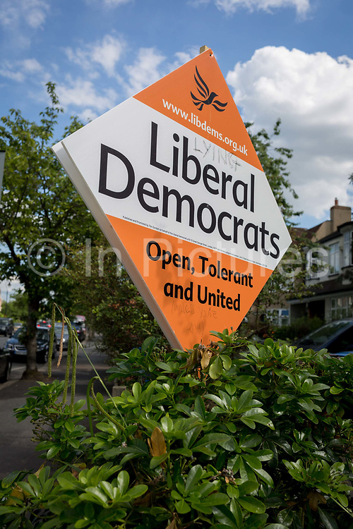 A general election placard for the Liberal Democrats political party with the added word lying outside a house in Dulwich, Southwark, on 1st June 2017, in south London, England.