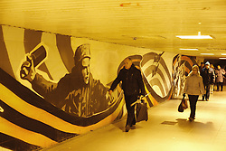 October 22, 2016 - Tula, Russia - People passing the underground crossing decorated with graffiti on the participation of the Soviet Army in World War II  in Tula city, 180 km southward from Moscow, on 22 October 2016.  Tula is one of the main centers of military industry in Russia since the old times. That's why it's a very conservative city, where residents traditionally support the current government. However, the city is economically depressed. (Credit Image: © Dmitry Ermakov/NurPhoto via ZUMA Press)