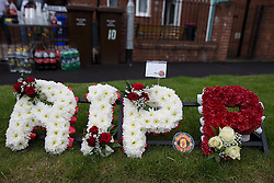 "© Licensed to London News Pictures . 28/08/2015 . Salford , UK . Flowers and tribute left on Sedan Close in Salford , from where the procession sets off . The funeral of Paul Massey at St Paul's CE Church in Salford . Massey , known as Salford's "" Mr Big "" , was shot dead at his home in Salford last month . Photo credit : Joel Goodman/LNP"