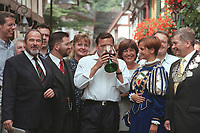 "16 JUL 1999 - UNKEL, GERMANY:<br /> Gerhard Schröder, Bundeskanzler, kostet den Wein der Stadt Unkel aus dem Glas der Weinkönigin, während der SPD Radtour ""Abschied vom Rhein""<br /> Gerhard Schroeder, Fed. Chancellor Germany, is drinking the wine from the city of Unkel from the glas of the wine-queen of Unkel, during a trip with a part of the SPD parliamentary group to a ""Goodbye from Rhine"" tour <br /> IMAGE: 19990716-01/09-09<br /> KEYWORDS: Alkohol, alcohol"