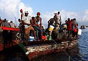 Fishermen bring in the day's catch in Stone Town in Zanzibar, Tanzania.