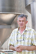 Tihomir Prusina, the oenologist. Outside stainless steel fermentation tanks with special design from Italy to allow for the removal of the grape pips after an initial cold maceration and before the main fermentation. Vinarija Citluk winery in Citluk near Mostar, part of Hercegovina Vino, Mostar. Federation Bosne i Hercegovine. Bosnia Herzegovina, Europe.