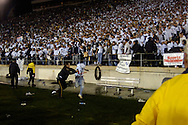 A fan is sprayed with pepper spray after running onto the field after the game