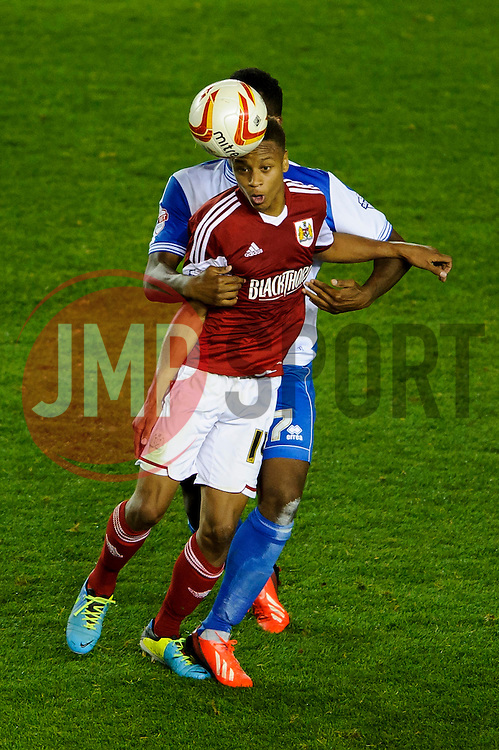 Bristol City Midfielder Bobby Reid (ENG) is challenged by Bristol Rovers Forward Ellis Harrison (WAL) during the second half of the match - Photo mandatory by-line: Rogan Thomson/JMP - Tel: 07966 386802 - 04/09/2013 - SPORT - FOOTBALL - Ashton Gate, Bristol - Bristol City v Bristol Rovers - Johnstone's Paint Trophy - First Round - Bristol Derby