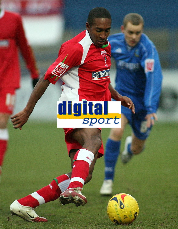 Photo: Paul Thomas.<br /> Macclesfield Town v Swindon Town. Coca Cola League 2. 23/12/2006.<br /> <br /> Ricky Shakes (L) of Swindon turns and tries to get past Danny Swailes