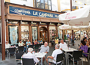 People sitting outside La Campana confiteria bakery shop and cafe restaurant, city centre Seville, Spain